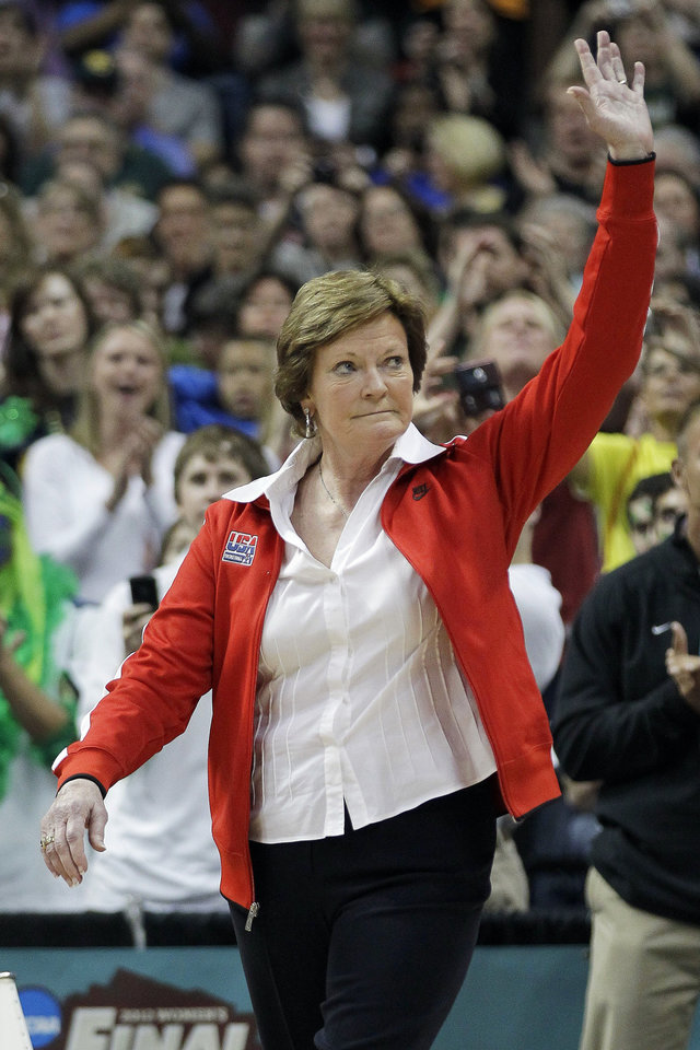 FILE - In this Sunday, April 1, 2012 file photo, Tennessee coach Pat Summitt  waves to the crowd during a half-time ceremony to honor past olympic coaches at an NCAA women's Final Four semifinal college basketball game between the Baylor and Stanford, in Denver. Summitt's retirement was voted the No. 2 Tennessee story in 2012. (AP Photo/Julie Jacobson, File)