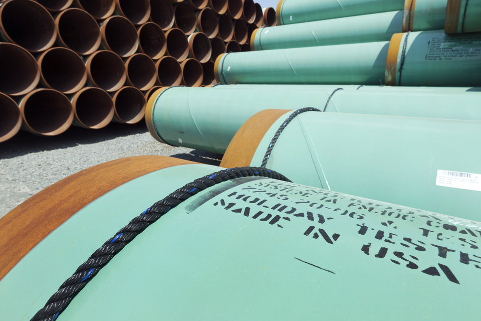 Photo -  Some of about 500 miles worth of coated steel pipe manufactured by Welspun Pipes, Inc., originally for the Keystone XL pipeline, is stored in Little Rock, Ark. AP Archives Photo   Danny Johnston - AP