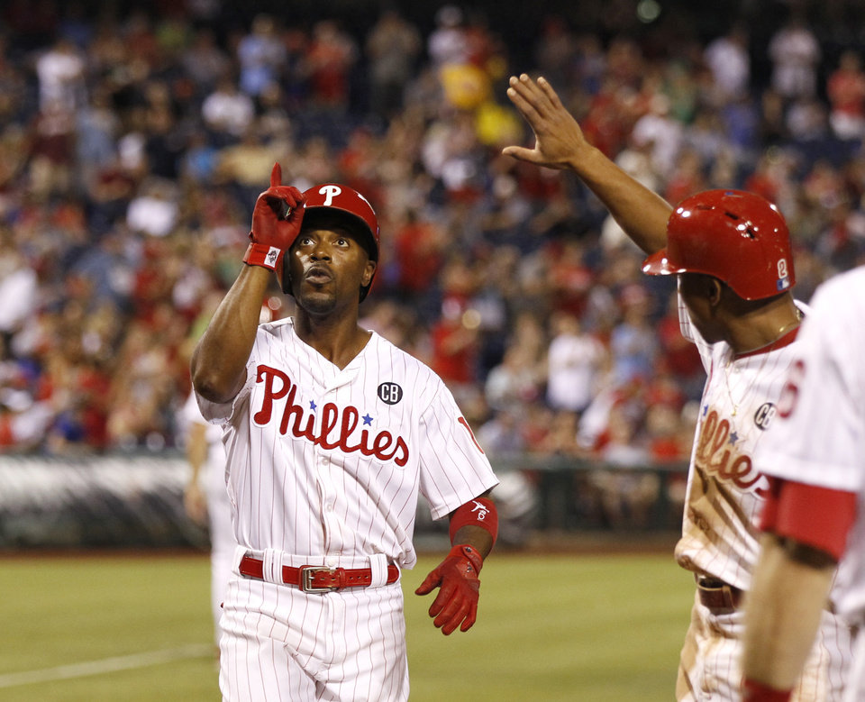 Photo - Philadelphia Phillies' Jimmy Rollins celebrates after he hits a two run home run in the fifth inning of a baseball game with teammate Ben Revere against the San Francisco Giants on Tuesday, July 22, 2014, in Philadelphia. (AP Photo/The Philadelphia Inquirer, Ron Cortes)