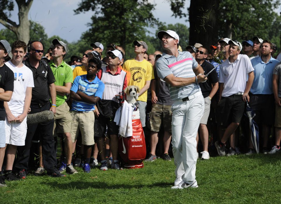 Photo - Rory McIlroy, of Northern Ireland, watches his shot from the rough on the eighth hole of the final round of the Bridgestone Invitational golf tournament, Sunday, Aug. 3, 2014, in Akron, Ohio. (AP Photo/Phil Long)