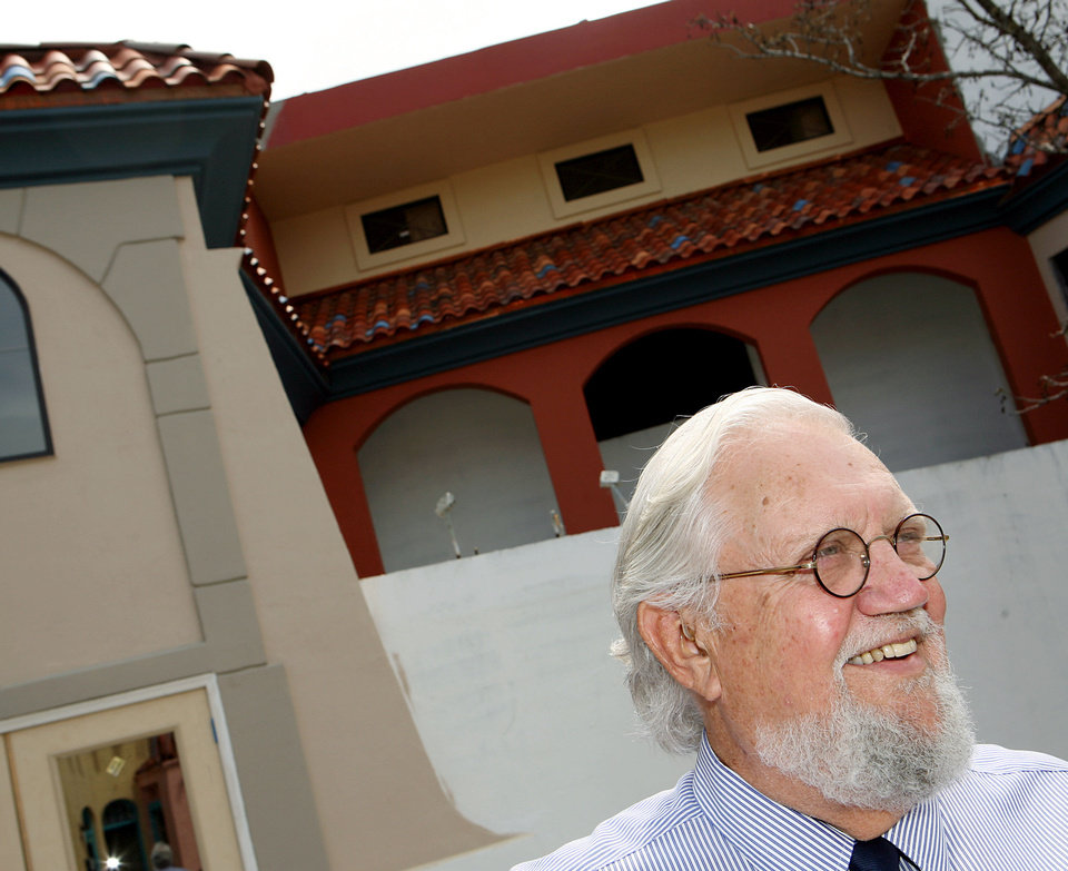 Photo - John Belt posed in front of The Plunge building he purchased in 2009. Belt died on March 10. His wife, Joy Reed Belt will continue renovations on the building. Photo by John Clanton, The Oklahoman Archives  John Clanton