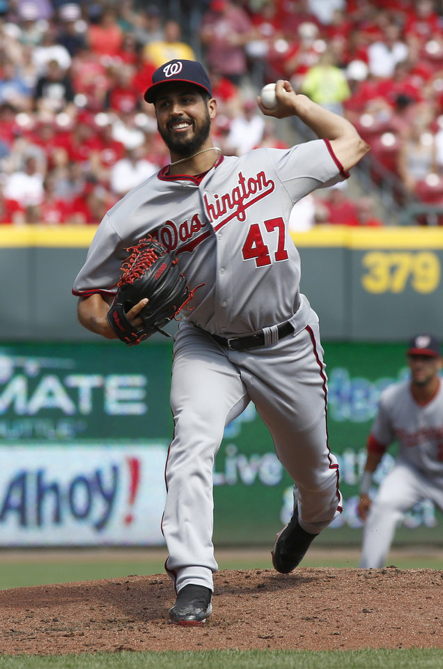 Photo - Washington Nationals starting pitcher Gio Gonzalez throws against the Cincinnati Reds in the first inning of a baseball game on Saturday, July 26, 2014, in Cincinnati. (AP Photo/David Kohl)