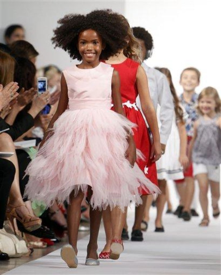 The Oscar de la Renta Spring 2013 childrenswear collection is modeled during Fashion Week, Wednesday, Sept. 12, 2012, in New York. (AP Photo/Jason DeCrow)