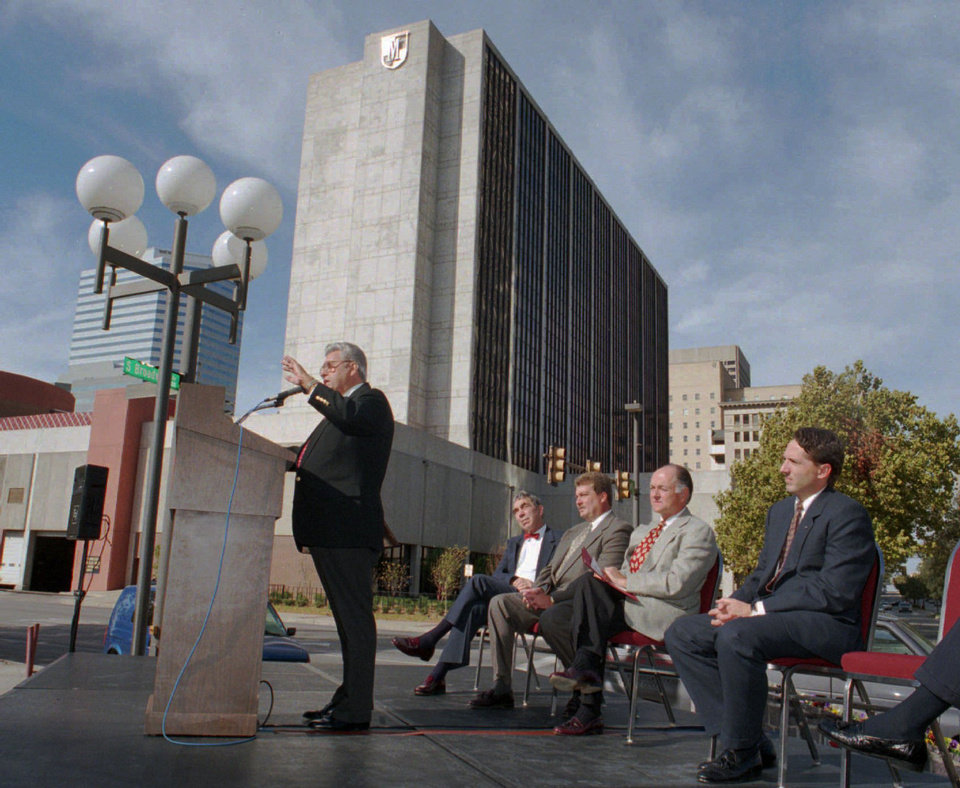 Photo - John Q. Hammons always took the stage announcing his hotel developments, including his first one as shown in this 1994 photo taken in front of the Cox Convention Center (then known as the Myriad) and what was then downtown's only open hotel (now the Sheraton).  STEVE SISNEY