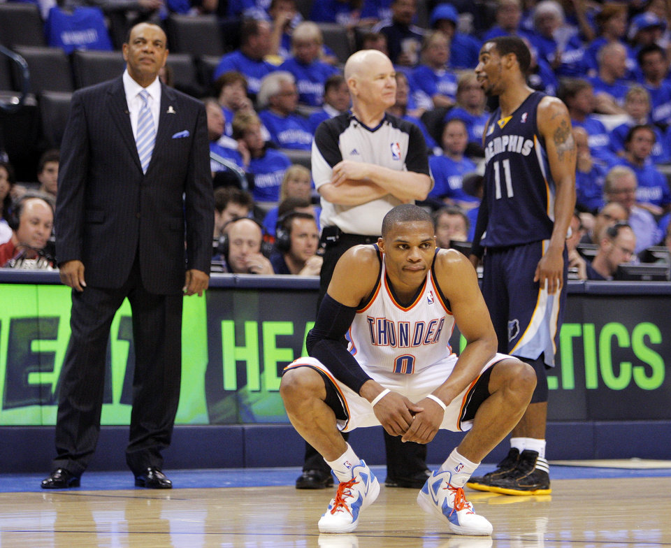 Photo - Oklahoma City's Russell Westbrook (0) kneels down in front of Memphis head coach Lionel Hollins, left, official Joe Crawford and Mike Conley (11) of Memphis late in the second half during game one of the Western Conference semifinals between the Memphis Grizzlies and the Oklahoma City Thunder in the NBA basketball playoffs at Oklahoma City Arena in Oklahoma City, Sunday, May 1, 2011. Memphis won, 114-101. Photo by Nate Billings, The Oklahoman