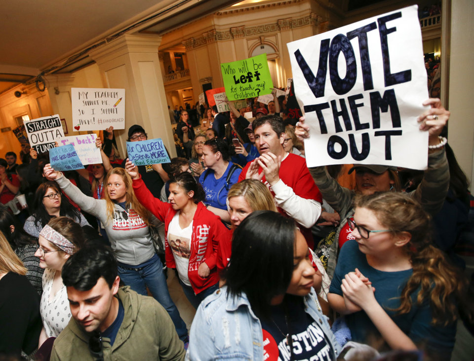 Photo - Teachers and protesters for increased education funding rally in front of the entrance to the Senate chamber on the fourth floor during the second day of a walkout by Oklahoma teachers at the state Capitol in Oklahoma City, Tuesday, April 3, 2018. Photo by Nate Billings, The Oklahoman