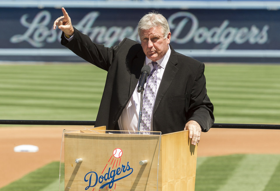 Photo - Los Angeles Dodgers former pitcher Tommy John praises his late friend, Dr. Frank Jobe during a memorial service at Dodger Stadium in Los Angeles Monday, April 7, 2014. Dr. Frank Jobe, was the surgeon who pioneered the elbow procedure that became known as Tommy John surgery and saved the careers of countless pitchers. Jobe died last month at 88. (AP Photo/Damian Dovarganes)