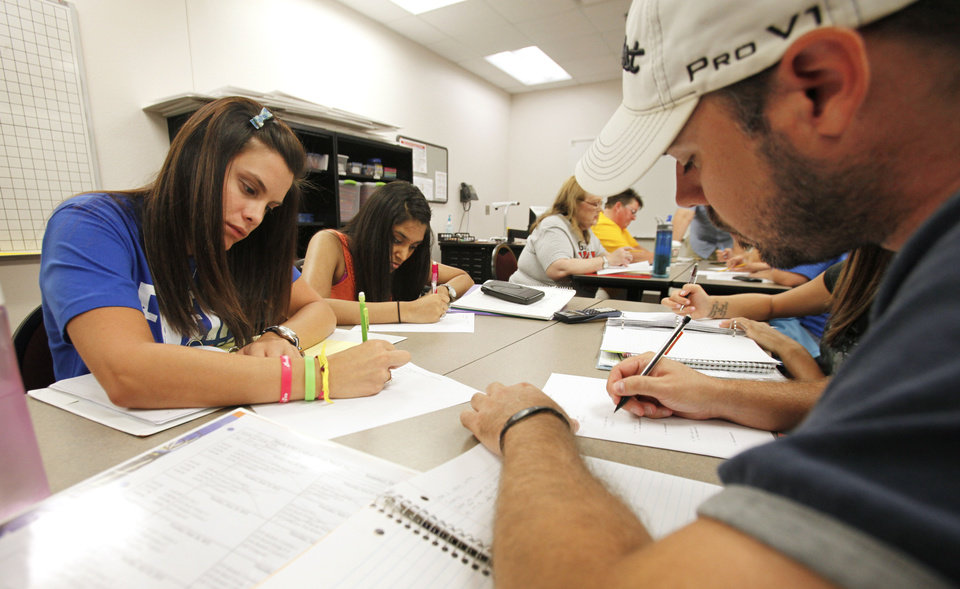 Photo - Lauren McKenzie, Bhavini Patel and Tripp Robertson work together in a math class at Oklahoma City Community College.