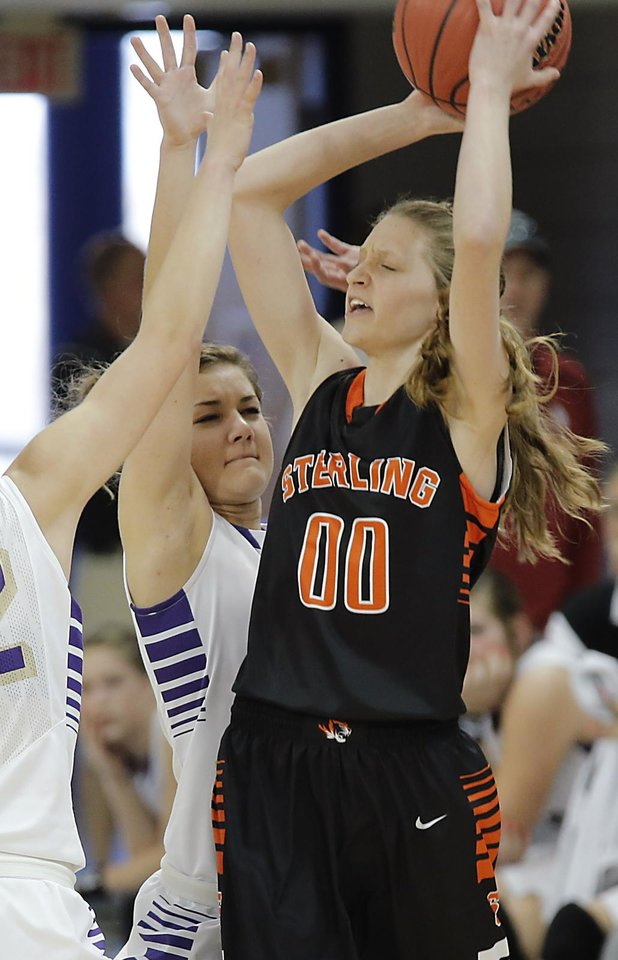 Okarche\'s Rae Grellner (13) defends on Sterling\'s Madeline Jacobi (00) during the Class A girls state quarterfinal game between Okarche and Sterling at Oklahoma City University on Thursday, Feb. 28, 2013, in Oklahoma City, Okla. Photo by Chris Landsberger, The Oklahoman