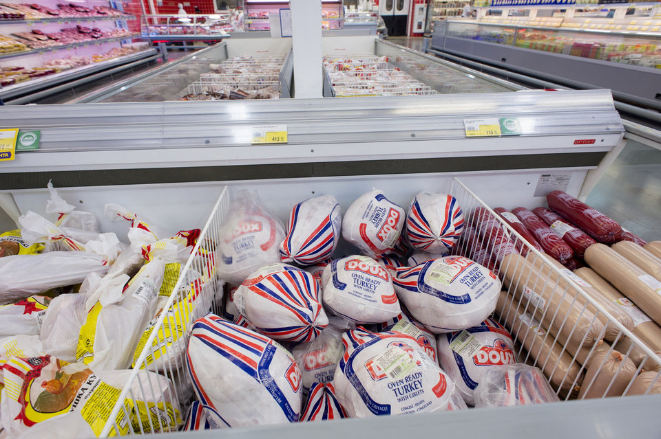 Photo - Imported meat products are displayed at a supermarket in Novosibirsk, about 2,800 kilometers (1,750 miles) east of Moscow, Russia, Thursday, Aug. 7, 2014. Russia banned most food imports from the West on Thursday in retaliation for sanctions over Ukraine, an unexpectedly sweeping move that will cost farmers in North America, Europe and Australia billions of dollars but will also likely lead to empty shelves in Russian cities. (AP Photo/Ilnar Salakhiev)