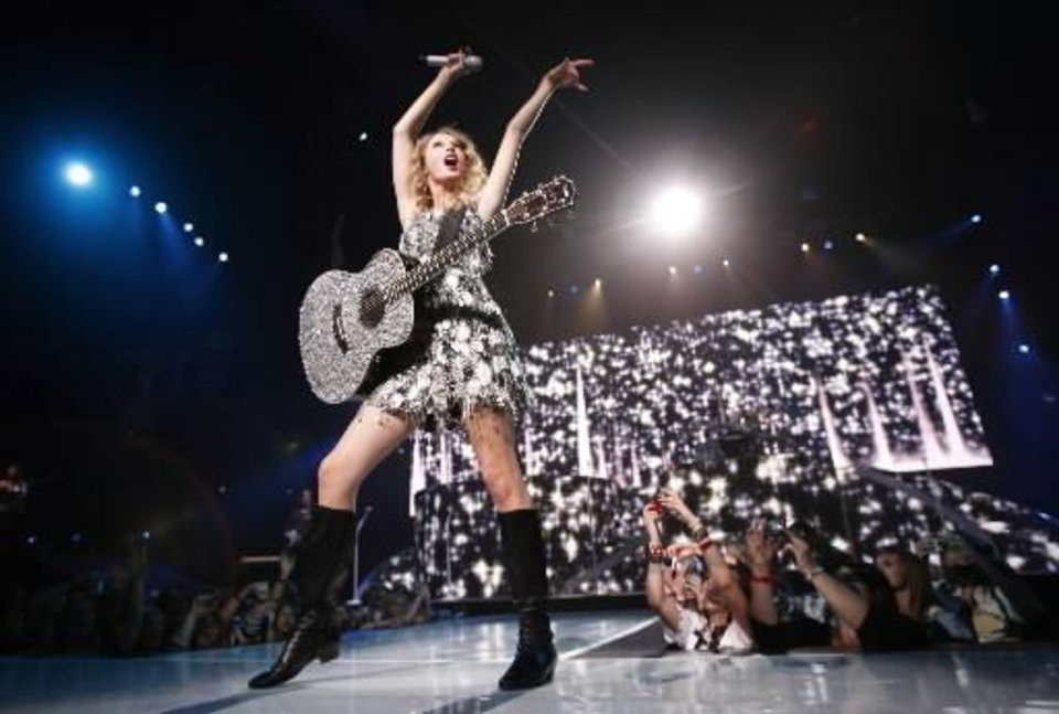 Photo -  Taylor  Swift sings during the Fearless tour concert, Wednesday, March, 31, 2010, at the Ford Center in Oklahoma City. Photo by Sarah Phipps