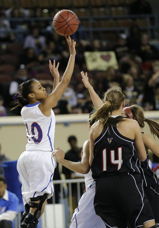 Photo - Millwood's Teanna Reid (10) shoots the ball over Verdigris' Courtney Risenhoover (14) during the 3A girls quarterfinals game between Millwood High School and Verdigris High School at the State Fair Arena on Thursday, March 7, 2013, in Oklahoma City, Okla. Photo by Chris Landsberger, The Oklahoman