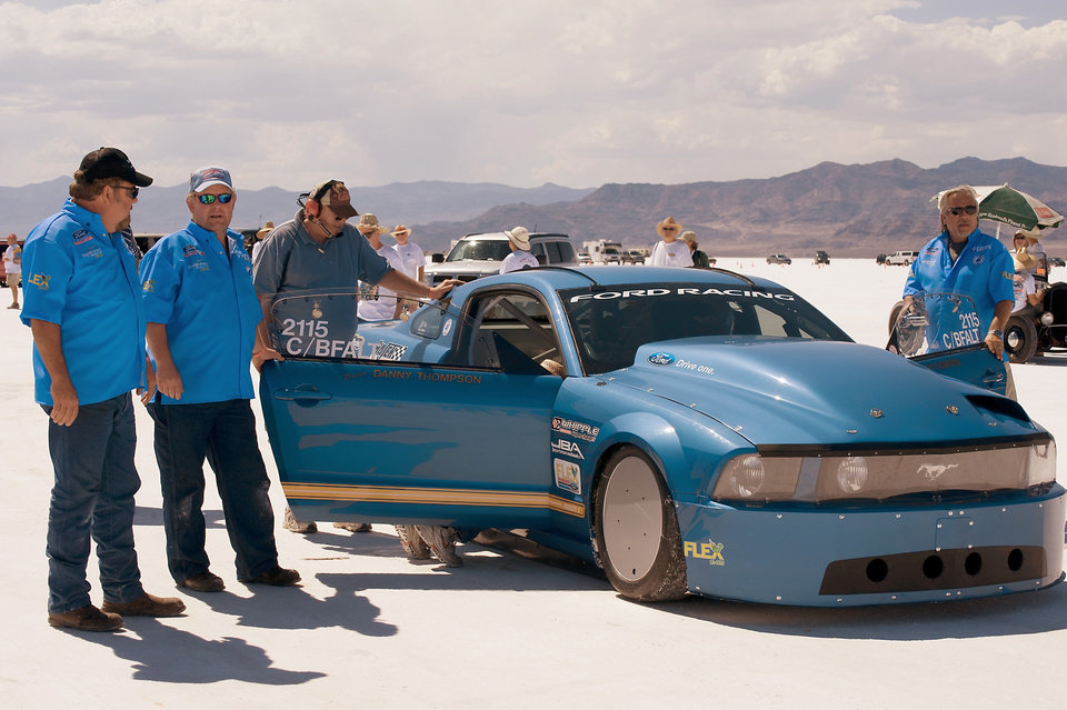 Photo - Brent Hajek, left and E85 Mustang crew members perform final checks at the starting line at Bonneville Salt Flats, Utah, just before the car's 252 mph run. PHOTO PROVIDED BY PATRICK QUIRK