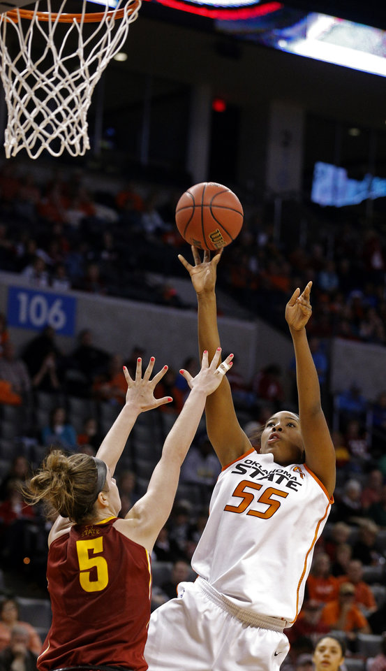 Photo - Oklahoma State's LaShawn Jones (55) shoots over Hallie Christofferson (5) during the Women's Big 12 basketball tournament at  Chesapeake Energy Arena  in Oklahoma City, Okla., Saturday, March 8, 2014. Photo by Sarah Phipps, The Oklahoman