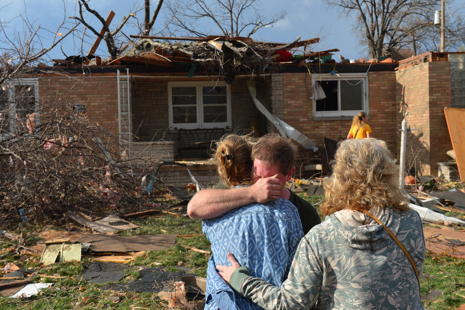 Photo - Ray Baughman embraces family shortly after his home was destroyed by a tornado that left a path of devastation through the north end of Pekin, Il., Sunday, Nov. 17, 2013. Intense thunderstorms and tornadoes swept across the Midwest on Sunday, causing extensive damage in several central Illinois communities while sending people to their basements for shelter. (AP Photo/Journal Star, Fred Zwicky) MANDATORY CREDIT