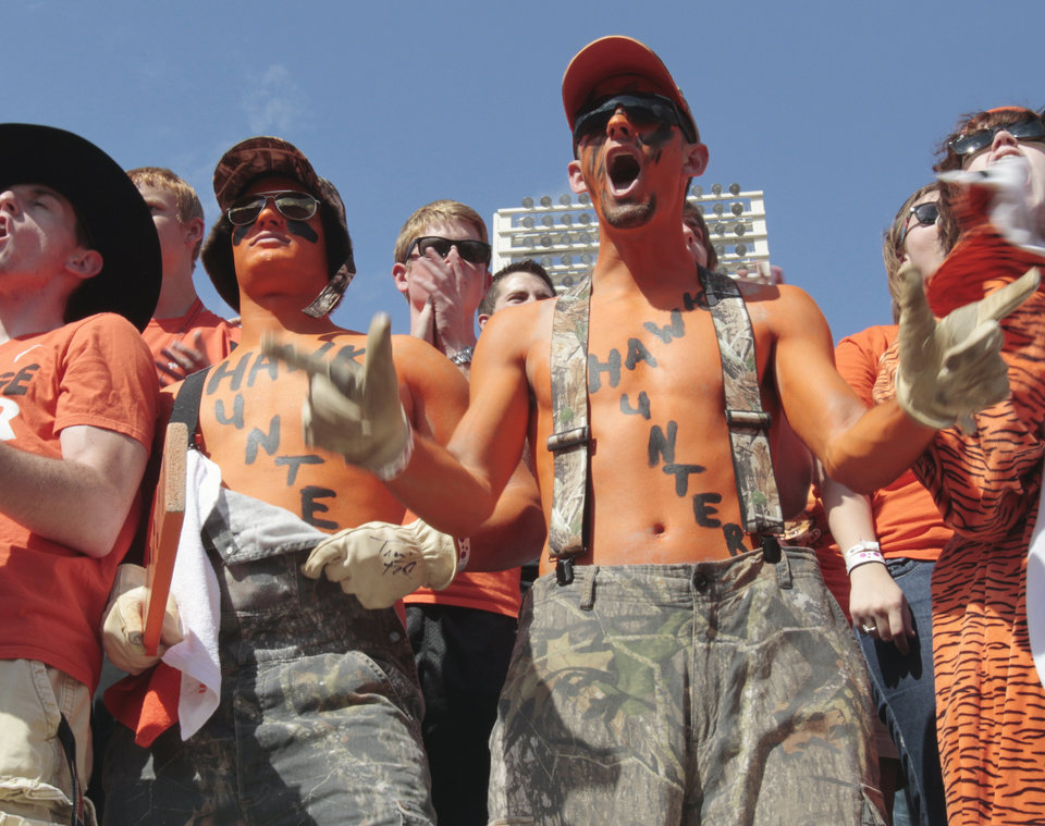 """Hawk Hunter"" fans Dylan Johnston and Corbit Bayliff cheer during the college football game between the Oklahoma State University Cowboys (OSU) and the University of Kansas Jayhawks (KU) at Boone Pickens Stadium in Stillwater, Okla., Saturday, Oct. 8, 2011 Photo by Steve Sisney, The Oklahoman"