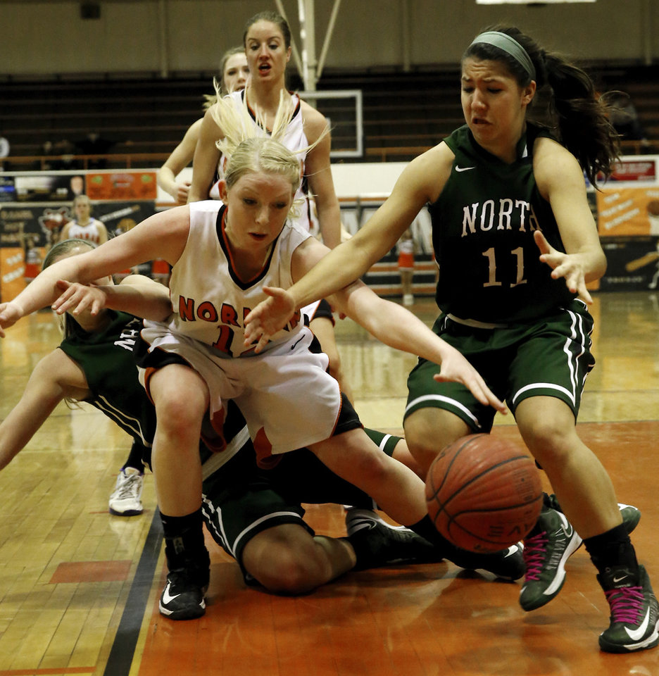 Albany Anderson, left, and Bri Kuestersteffen fight for a loose ball as the Norman High School Tigers play the Norman North Timberwolves on Friday, Feb. 15, 2013  in Norman, Okla. Photo by Steve Sisney, The Oklahoman