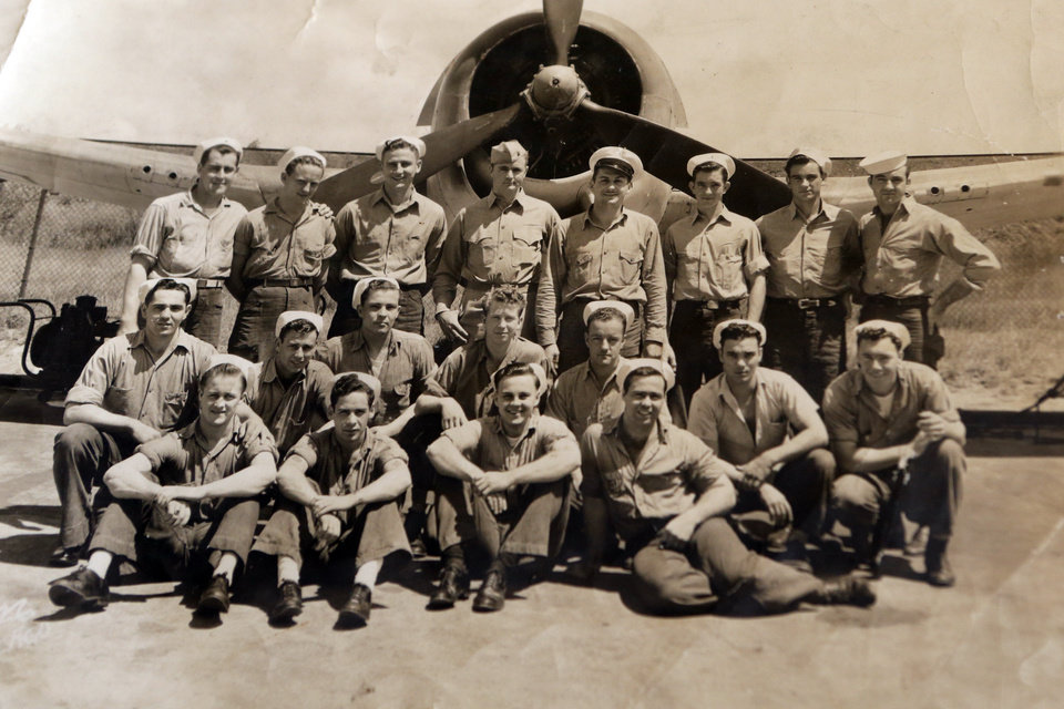 Photo - World War II Veteran Curtis Sadler shows an early photograph of his group on Thursday, Sept. 17, 2015 in Oklahoma City, Okla. Sadler is second from the left on the middle row. Photo by Steve Sisney, The Oklahoman