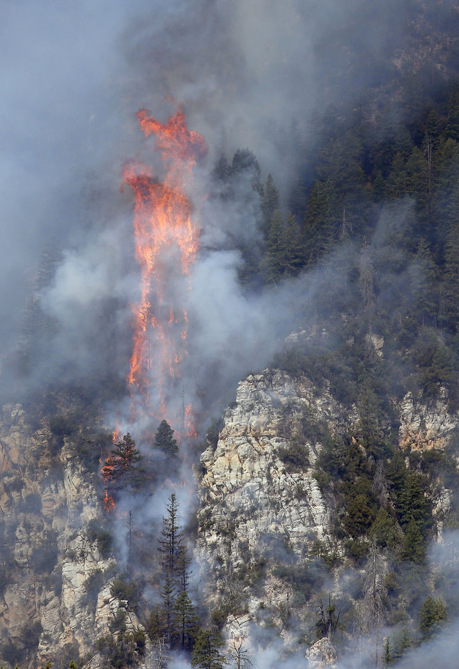 Photo - Flames, some over 125-feet tall, burn in the Slide Fire up Oak Creek Canyon on Friday, May 23, 2014, near Flagstaff, Ariz.  The fire has burned approximately 7,500 acres and is five percent contained. (AP Photo/Ross D. Franklin)