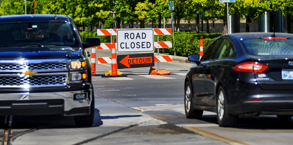 Photo - A road closure sign is pictured in downtown Oklahoma City. A key route for downtown commuters will be closed for about a week starting Tuesday night. [The Oklahoman archives]