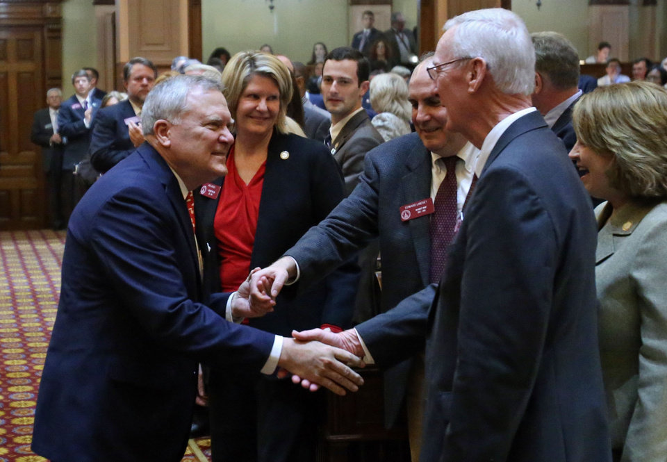 Photo - Georgia Gov. Nathan Deal , left, greets House Majority Whip Edward Lindsey, center, and House Majority Leader Larry O'Neal, R-Bonaire, right, before he delivers the State of the State address, Thursday, Jan. 17, 2013, in Atlanta.  (AP Photo/Atlanta Journal-Constitution, Jason Getz  )  MARIETTA DAILY OUT; GWINNETT DAILY POST OUT; LOCAL TV OUT; WXIA-TV OUT; WGCL-TV OUT