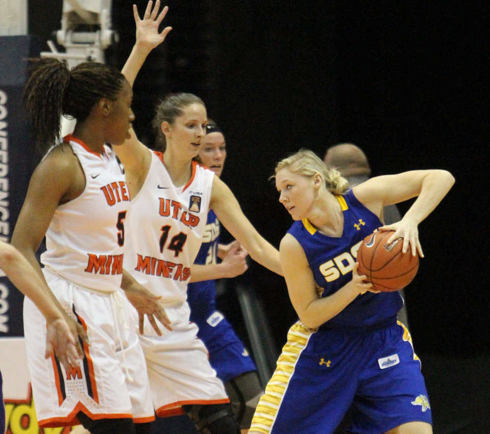 Photo - South Dakota State's Mariah Clarin, right, tries to work the ball inside against UTEP during an NCAA college basketball game in the semifinals of the WNIT, Wednesday, April 2, 2014, in El Paso, Texas. (AP Photo/El Paso Times, Rudy Gutierrez) EL PASO OUT   JUAREZ, MEXICO, OUT