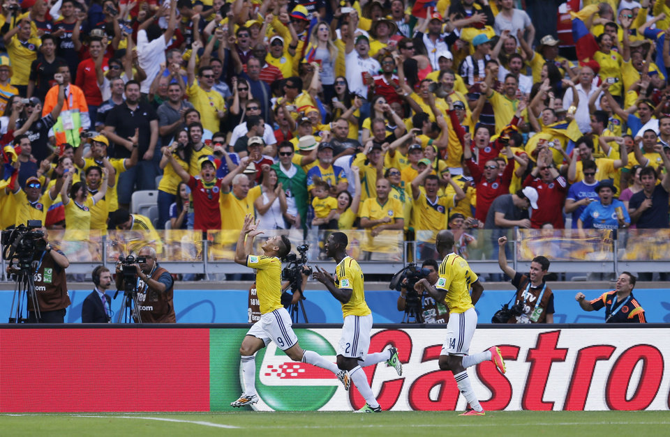 Photo - Colombia's Teofilo Gutierrez, left, celebrates after scoring his side's second goal during the group C World Cup soccer match between Colombia and Greece at the Mineirao Stadium in Belo Horizonte, Brazil, Saturday, June 14, 2014.  (AP Photo/Frank Augstein)