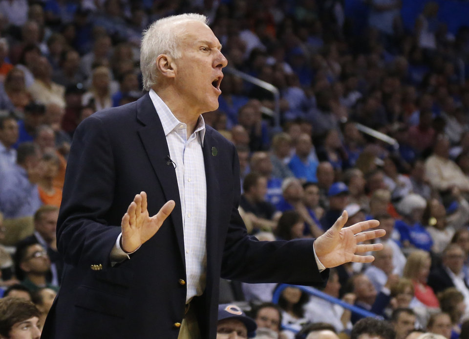 Photo - San Antonio coach Gregg Popovich shouts to his team in the third quarter of an NBA basketball game against the Oklahoma City Thunder in Oklahoma City, Thursday, April 3, 2014. Oklahoma City won 106-94. (AP Photo/Sue Ogrocki)