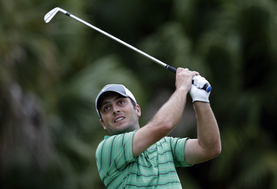 Photo - Francesco Molinari, of Italy, hits from the 13th tee during the first round of the Cadillac Championship golf tournament on Thursday, March 6, 2014, in Doral, Fla. (AP Photo/Wilfredo Lee)