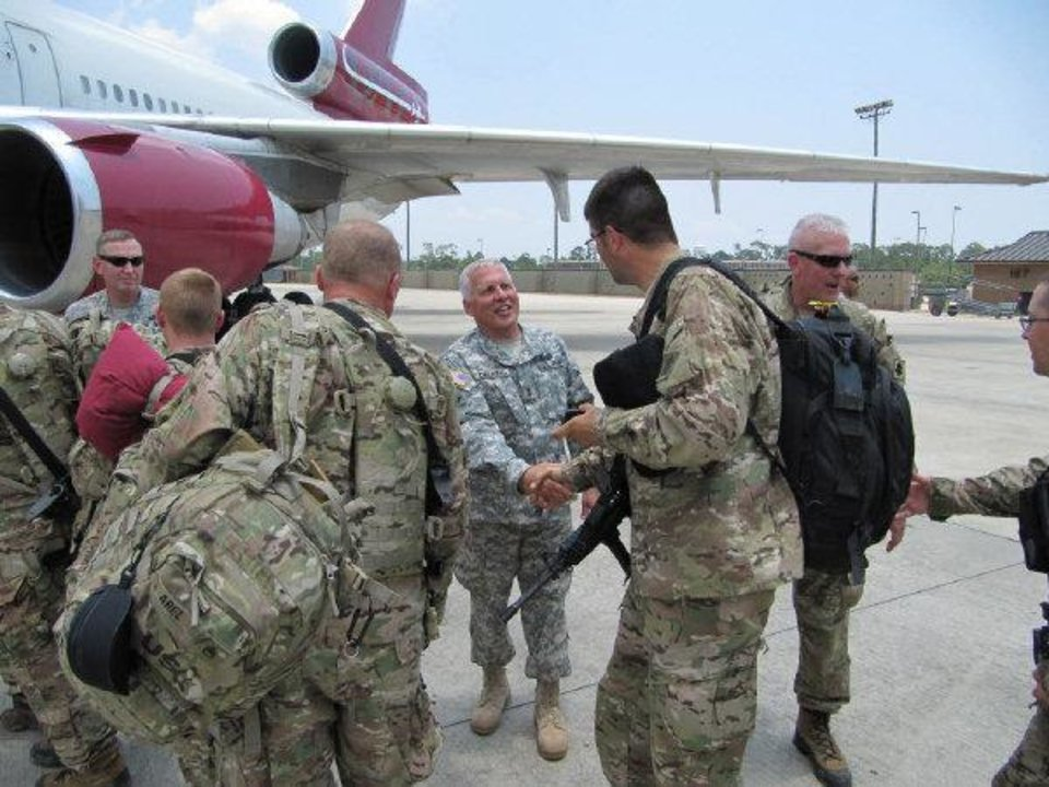 Photo - Maj. Gen. Myles Deering, Oklahoma's adjutant general, center, is pictured here in June as he met with members of the Oklahoma Army National Guard 's 45th Infantry Brigade as they were boarding a plane for Afghanistan.  Photo by Manny Gamallo - TULSA WORLD