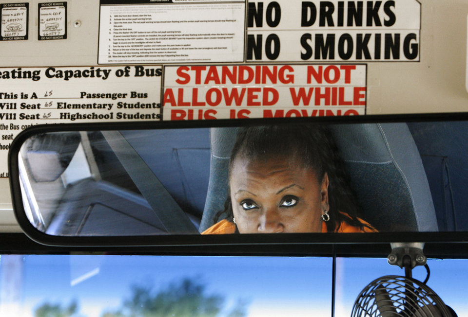 Photo - Tonda Russell  is a bus driver  and trains new drivers for  Oklahoma City Public Schools. She was photographed driving a bus at the district's transportation center in northeast Oklahoma City, Thursday,  Aug. 7, 2008.   BY JIM BECKEL, THE OKLAHOMAN
