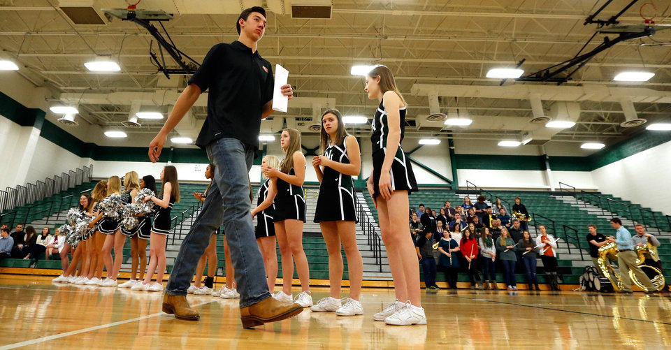 Photo - John Kolar is introduced as he and others make their college intentions known at Norman North High School on Wednesday, Feb. 4, 2015  in Norman, Okla. Kolar is going to Oklahoma State University.  Photo by Steve Sisney, The Oklahoman