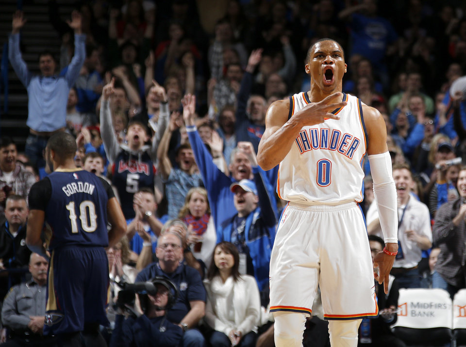 Photo - Oklahoma City's Russell Westbrook (0) celebrates after a basket during an NBA game between the Oklahoma City Thunder and the New Orleans Pelicans at Chesapeake Energy Arena on Friday, Feb. 6, 2015. Photo by Bryan Terry, The Oklahoman