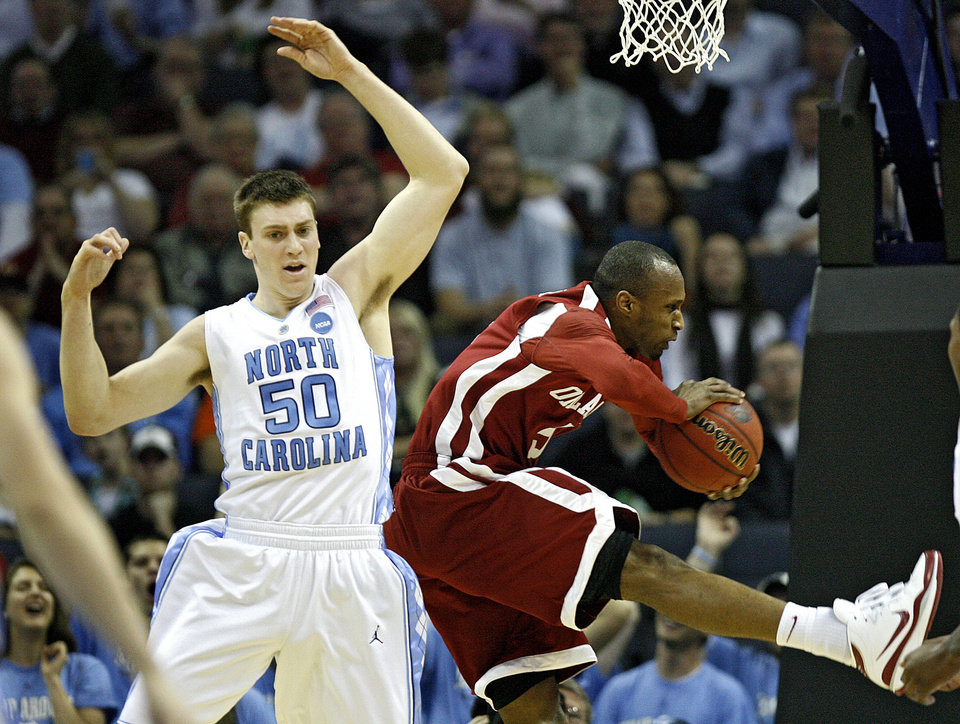Photo - Oklahoma's Tony Crocker (5) pulls in a rebound over North Carolina's Tyler Hansbrough (50) during the second half in the Elite Eight game of NCAA Men's Basketball Regional between the University of North Carolina and the University of Oklahoma at the FedEx Forum on Sunday, March 29, 2009, in Memphis, Tenn.