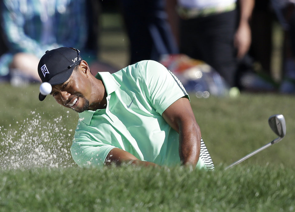 Photo - Tiger Woods hits out of a bunker on the 10th hole during the second round of the Honda Classic golf tournament, Friday, Feb. 28, 2014 in Palm Beach Gardens, Fla. (AP Photo/Wilfredo Lee)
