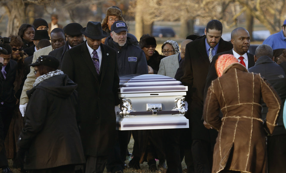 Photo - ADVANCE FOR USE SUNDAY, DEC. 22 AND THEREAFTER - FILE - In this Feb. 9, 2013 file photo, the remains of 15-year-old Hadiya Pendleton are taken to her final resting place at the Cedar Park Cemetery in Calumet Park, Ill. Pendleton was killed on Jan. 29, when a gunman opened fire on her and some friends seeking shelter in a park from the rain about a mile from President Obama's Chicago home. First lady Michelle Obama attended the funeral with Senior White House Adviser Valerie Jarrett and Secretary of Education Arne Duncan. Chicago's continuing battle against gang violence was voted as one of the top 10 stories in Illinois for 2013. (AP Photo/Charles Rex Arbogast, File)