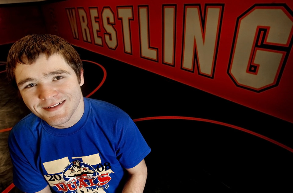 Carl Albert High School\'s Justin Hill poses for a photo in the wrestling room at Carl Albert High School on Wednesday, Jan. 16, 2008, in Oklahoma City, Okla. Hill is still involved with the Titans\' high school wrestling program despite having a career ending back injury. BY CHRIS LANDSBERGER, THE OKLAHOMAN