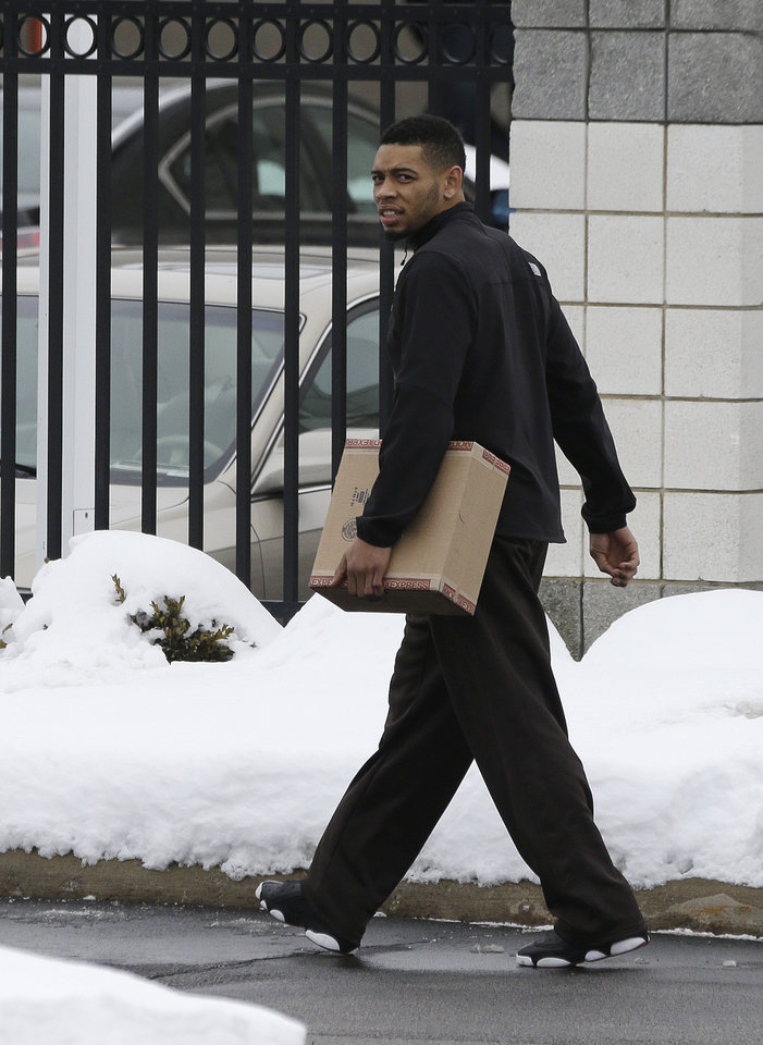 Photo - Cleveland Browns defensive back Joe Haden walks to his vehicle at the Browns' NFL football training facility Monday, Dec. 31, 2012, in Berea, Ohio. One day after ending yet another dismal season with a loss in Pittsburgh, Cleveland fired coach Pat Shurmur and general manager Tom Heckert, the first moves in what is expected to be a massive offseason overhaul by new owner Jimmy Haslam. (AP Photo/Tony Dejak)
