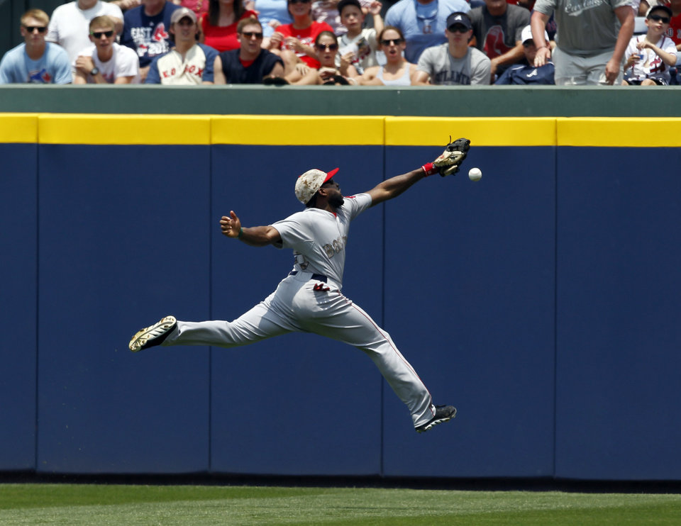 Photo - Boston Red Sox outfielder Jackie Bradley cannot reach a 2-RBI double hit over his head by Atlanta Braves' Justin Upton  during the third inning of a baseball game on Monday, May 26, 2014, in Atlanta, Ga. (AP Photo/Butch Dill)