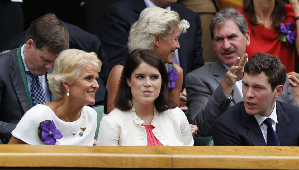 Photo - Princess Eugenie, center, and Jack Brooksbank, right, sit in the Royal Box on centre court prior to the women's singles final between Eugenie Bouchard of Canada and Petra Kvitova of the Czech Republic at the All England Lawn Tennis Championships in Wimbledon, London, Saturday July 5, 2014. (AP Photo/Sang Tan)