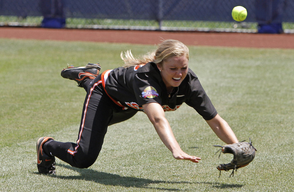 Photo - Oklahoma State's Sammy Jo Diffendaffer (33) misses the ball in the fifth inning of  a Women's College World Series softball game between Oklahoma State University and California at ASA Hall of Fame Stadium in Oklahoma City, Saturday, June 4, 2011. California won, 6-2. Photo by Bryan Terry, The Oklahoman
