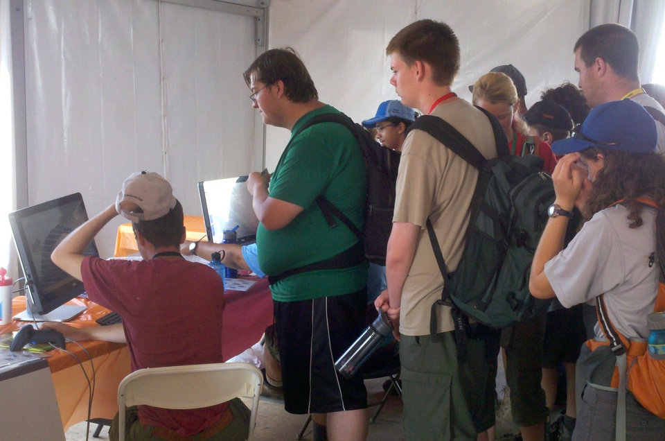 "In a photo provided by the Virginia Bioinformatics Institute, Boy Scouts participate in a Virginia Tech educational program that shows how viruses spread Friday, July 19, at the Boy Scouts National Jamboree in Mount Hope, W.Va. The Virus Tracker program combines technology with the game of tag. It's meant to show how viruses are spread. I have heard that Scouts earn points by ""infecting"" other players through bar-coded wristbands.  (AP Photo/Virginia Bioinformatics Institute, Kristy Collins)"