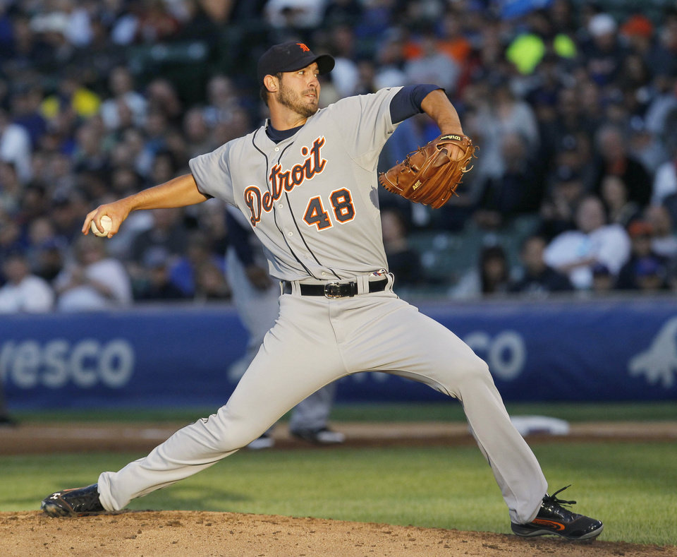 Photo -   Detroit Tigers starting pitcher Rick Porcello delivers during the second inning of an interleague baseball game against the Chicago Cubs on Wednesday, June 13, 2012, in Chicago. (AP Photo/Charles Rex Arbogast)
