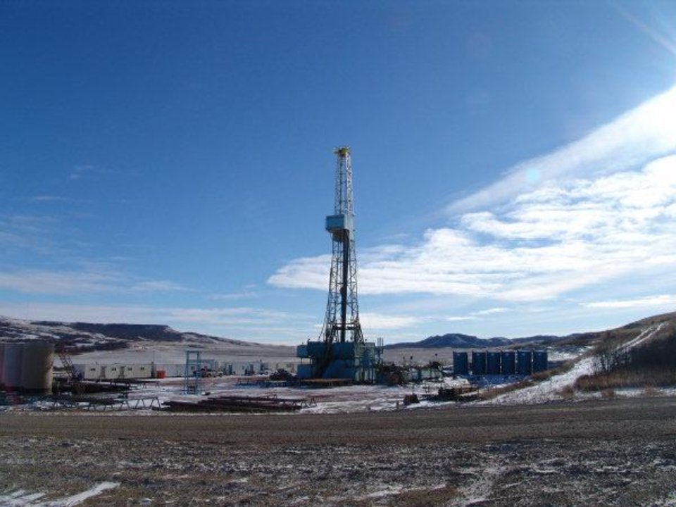 An Enid-based Continental Resources Inc. drilling rig works in the Bakken Shale field of North Dakota in 2008. The Federal Housing Finance Agency says the energy boom has carried home prices up with it in counties of high-energy employment. <strong>Provided - PROVIDED BY CONTINENTAL RESOURCE</strong>
