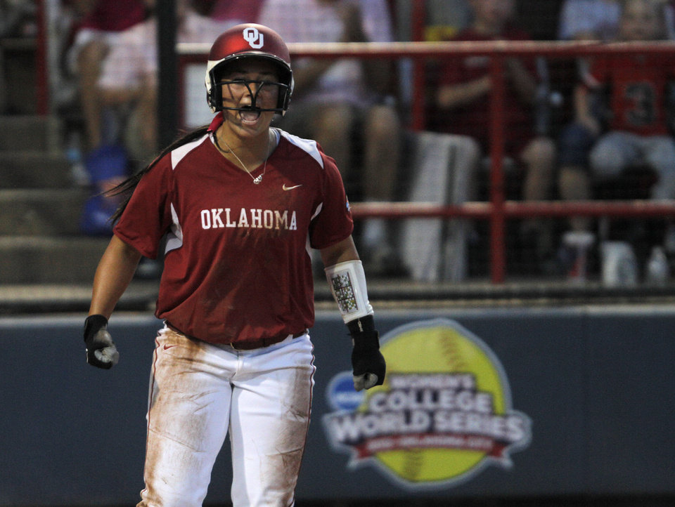 Oklahoma's Lauren Chamberlain (44) celebrates during a Women's College World Series game between OU and Alabama at ASA Hall of Fame Stadium in Oklahoma City, Monday, June 4, 2012.  Photo by Garett Fisbeck, The Oklahoman