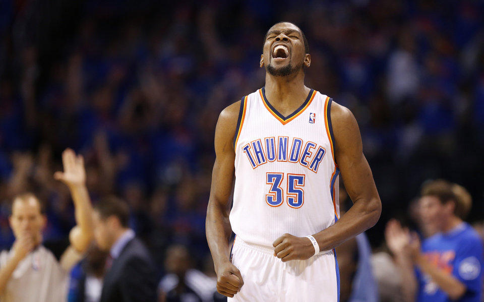 Photo - Oklahoma City's Kevin Durant (35) celebrates after a 3-pointer during Game 7 in the first round of the NBA playoffs between the Oklahoma City Thunder and the Memphis Grizzlies at Chesapeake Energy Arena in Oklahoma City, Saturday, May 3, 2014. Photo by Nate Billings, The Oklahoman