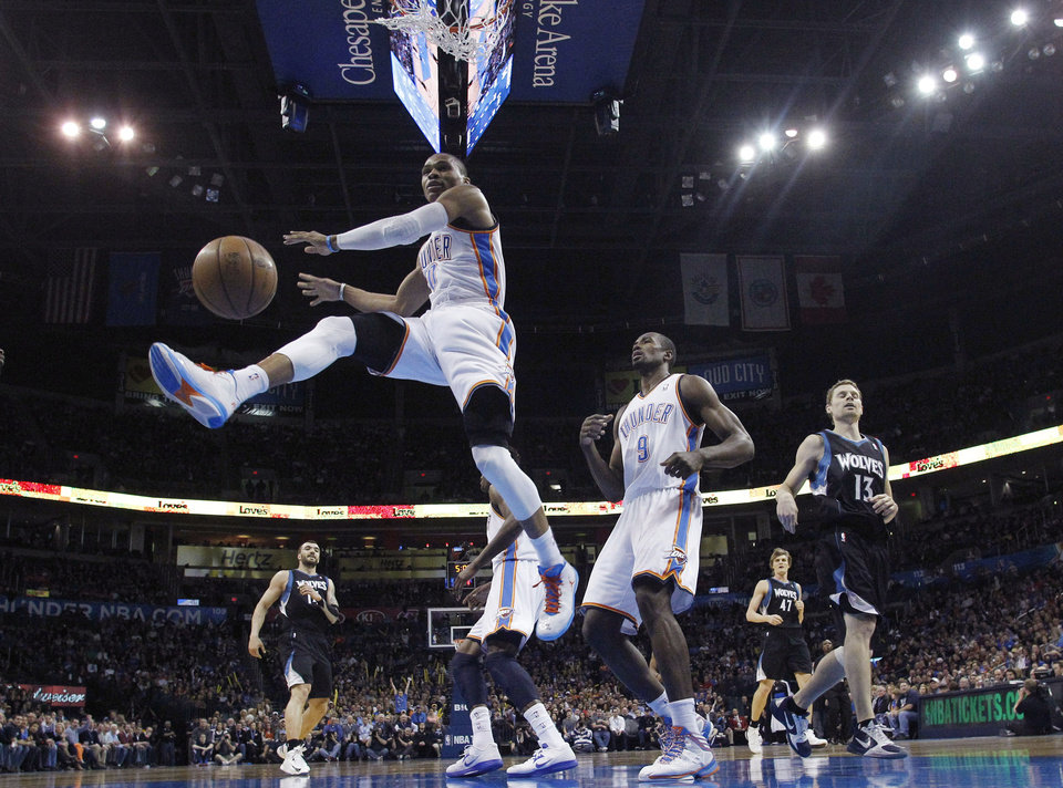 Oklahoma City Thunder guard Russell Westbrook (0) watches the ball after a dunk against the Minnesota Timberwolves duiring the first quarter of an NBA basketball game in Oklahoma City, Friday, Feb. 22, 2013. (AP Photo/Sue Ogrocki)