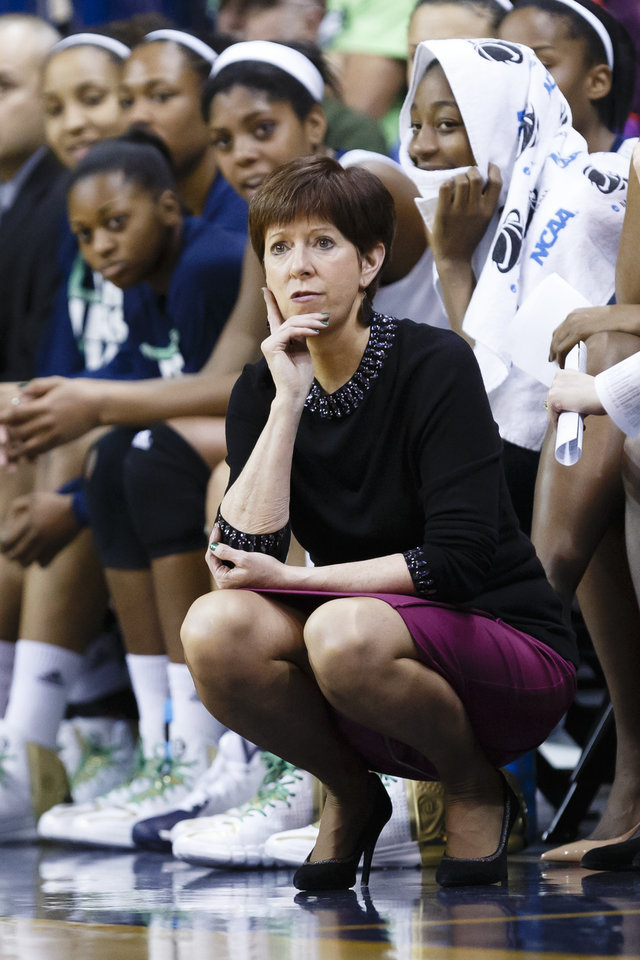 Photo - Notre Dame head coach Muffet McGraw watches her team play against Robert Morris during the second half in a first-round game in the NCAA women's college basketball tournament, Saturday, March 22, 2014, in Toledo, Ohio. Notre Dame defeated Robert Morris 93-42. (AP Photo/Rick Osentoski)