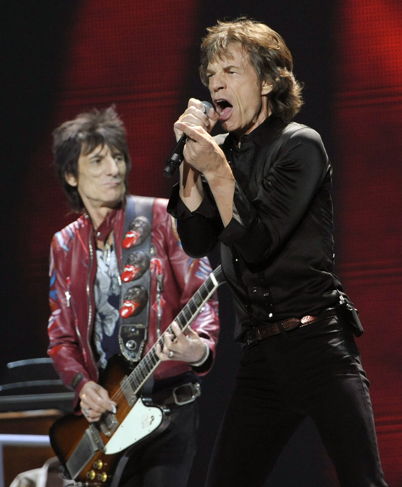 Photo - Mick Jagger, right, and Ron Wood of the Rolling Stones perform on the kick-off of the band's