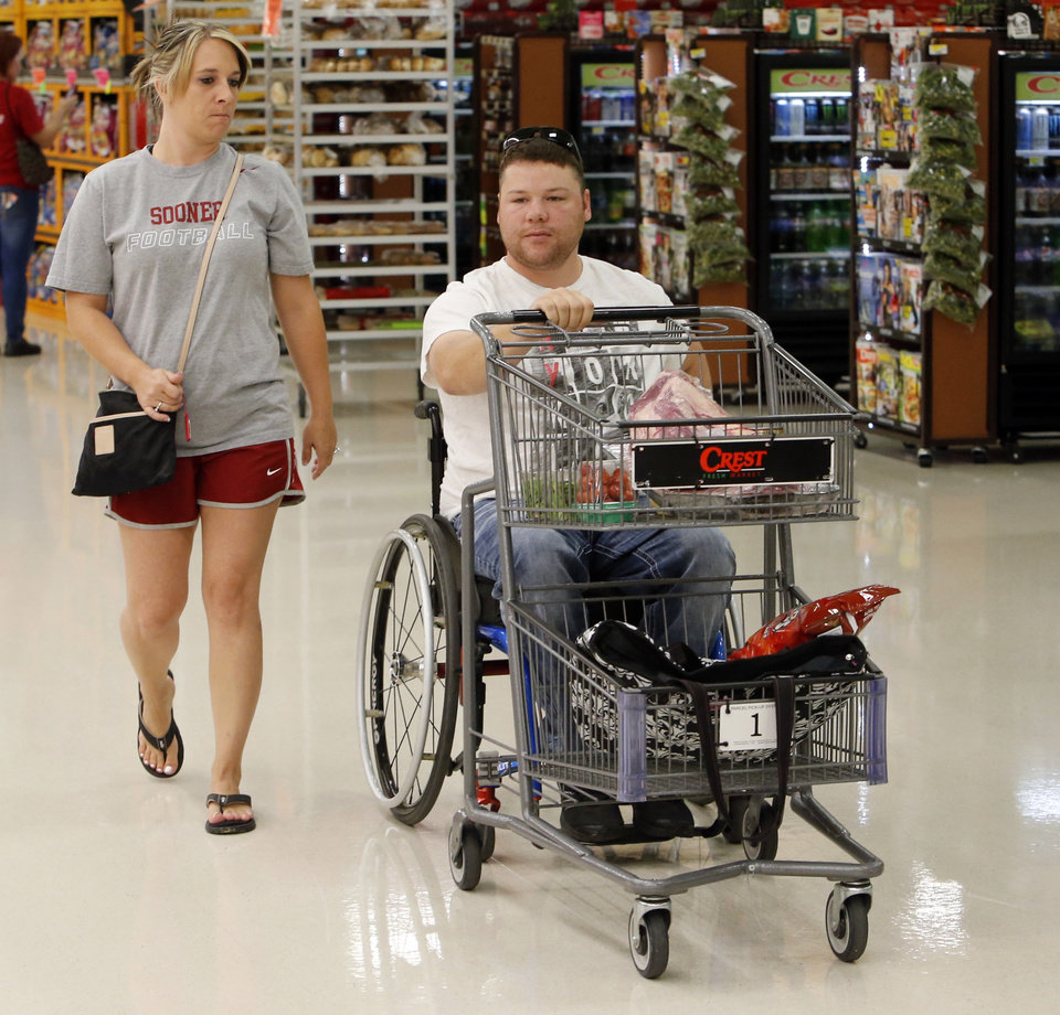 Photo -  EH Pittman and wife, Jean, shop at Crest Market in Norman. Pittman will be honored Friday with a Jim Thorpe Rehabilitation Award. Photo by Steve Sisney, The Oklahoman   STEVE SISNEY -  THE OKLAHOMAN